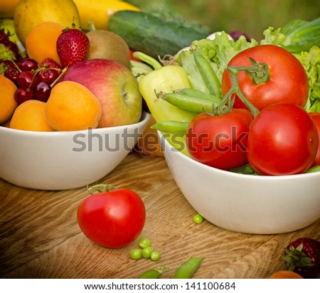 Fresh fruits and vegetables - raw food (organic food) - stock photo