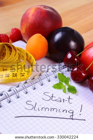 Fresh fruits and vegetables with tape measure and notebook for writing notes, concept of slimming, diet and healthy nutrition - stock photo