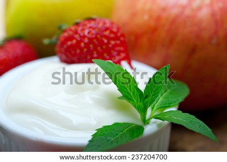 fresh fruits and whole milk yogurt on a rustic wood table - stock photo
