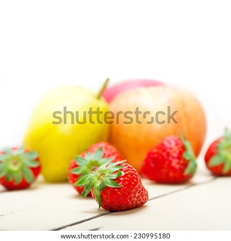 fresh fruits apples pears and strawberry on a white wood table - stock photo