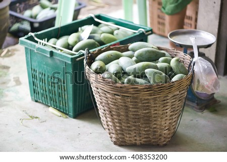 Fresh fruits at a market. Ready for sale. Mango. - stock photo