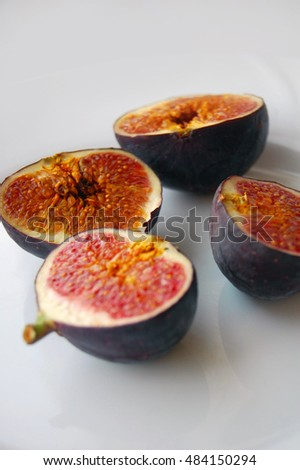 fresh fruits background with ripe figs on white plate