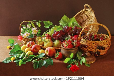 Fresh fruits, berries and flowers in the basket - stock photo