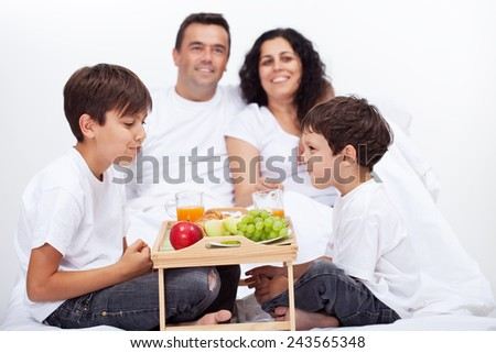 Fresh fruits breakfast in bed for family with kids - stock photo