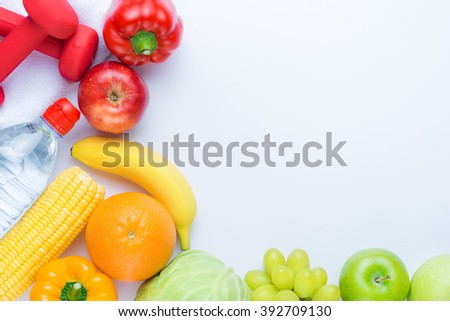 Fresh fruits close up. Healthy eating, dieting concept, clean eating with copy space isolated on white background. View from the top  - stock photo