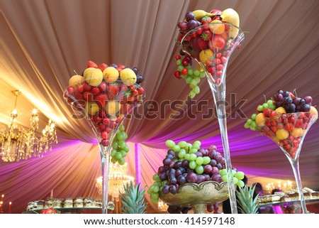 fresh fruits in a vase on the table - stock photo