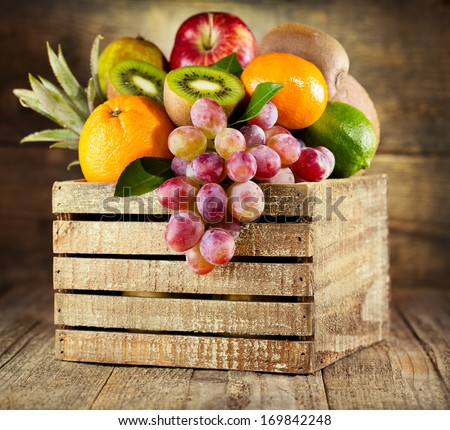 fresh fruits in wooden box - stock photo