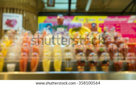 Fresh fruits juices chilled in ice, a popular street food of Thailand , blurred - stock photo