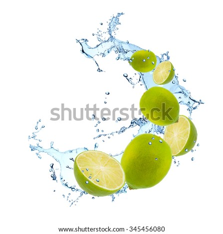 Fresh fruits, lime falling in water splash, isolated on white background