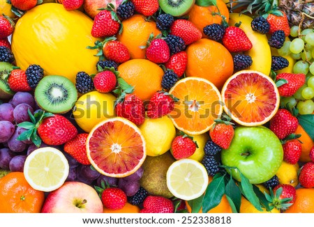 Fresh fruits.Mixed fruits background.Healthy eating, dieting. - stock photo