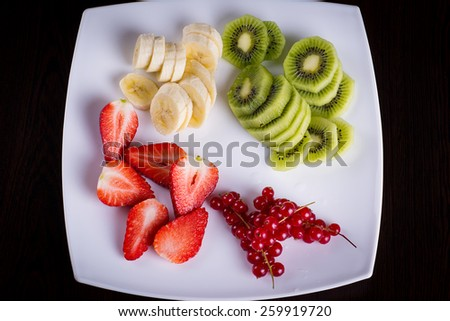 Fresh fruits on a plate - stock photo
