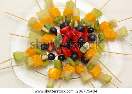 Fresh Fruits On Skewers Sticks For Party - stock photo