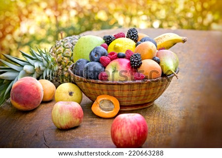 Fresh fruits on table - stock photo