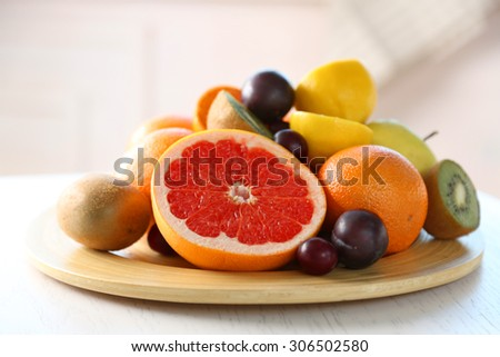 Fresh fruits on table, close up - stock photo