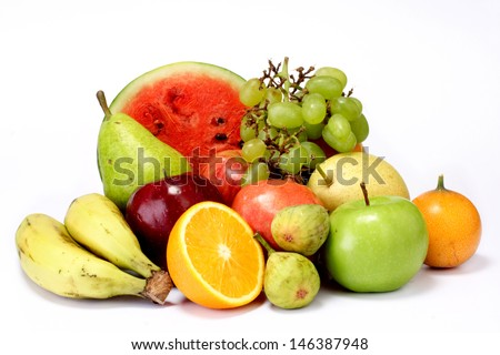 Fresh fruits on white - stock photo