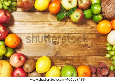 Fresh fruits on wooden background. Healthy eating and dieting concept. Winter assortment. Copy space. Top view - stock photo