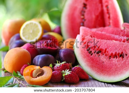 fresh fruits on wooden table  - stock photo