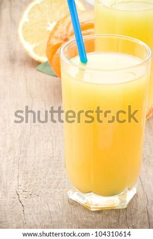 fresh fruits orange juice in glass on wood board background - stock photo