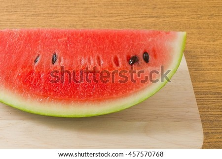 Fresh Fruits, Ripe and Sweet Refreshing Watermelon on A Wooden Cutting Board. - stock photo