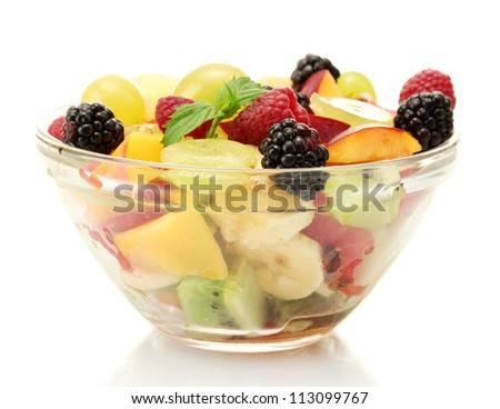 fresh fruits salad in bowl isolated on white