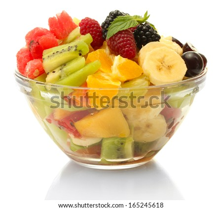 fresh fruits salad in bowl isolated on white - stock photo