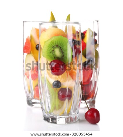 Fresh fruits salad in glasses isolated on white - stock photo