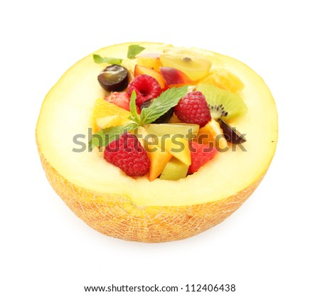 fresh fruits salad in melon, isolated on white