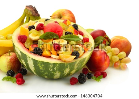 fresh fruits salad in watermelon, fruits and berries, isolated on white