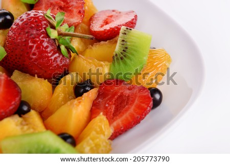 Fresh fruits salad on plate close up - stock photo