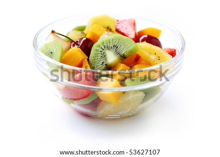 Fresh fruits salad on white background - stock photo