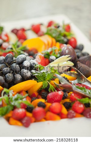 Fresh Fruits Sliced and Assorted on a Plate - stock photo