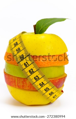 fresh fruits with tape measure and diet against overweight - stock photo