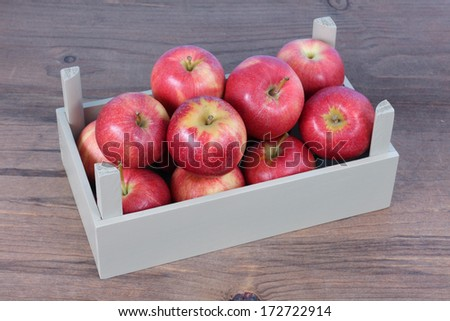 fresh gala apple in crate on table