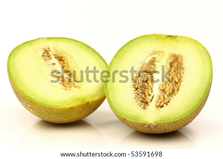 fresh galia melon halves on a white background