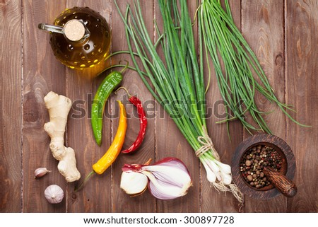 Fresh garden herbs and spices on wooden table. Top view - stock photo
