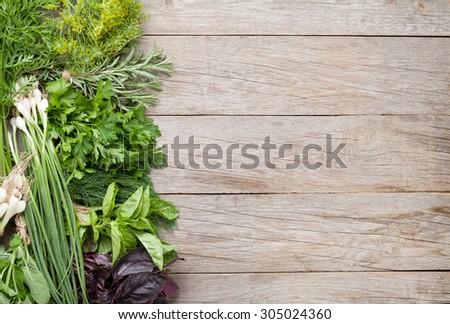 Fresh garden herbs on wooden table. Top view with copy space   - stock photo