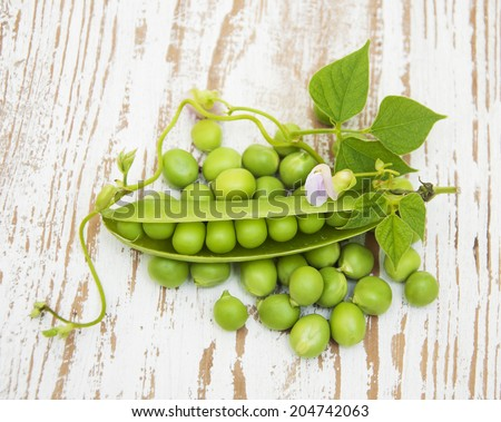 Fresh Garden Peas  on a  wooden background