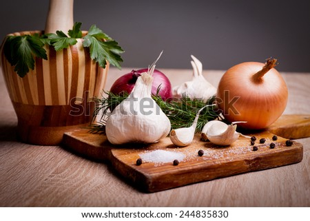 fresh garlic and onion vegetables with parsley spice and dill - stock photo