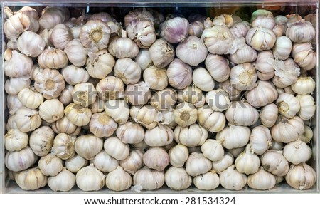 Fresh garlic in the glass box for display in super market. - stock photo