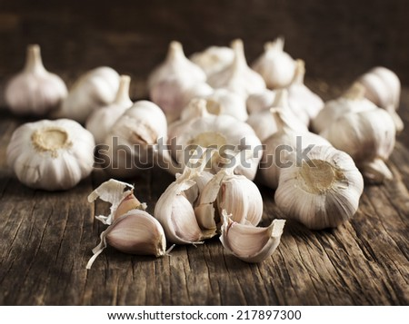 Fresh Garlic on the Wooden Table. Selective focus - stock photo