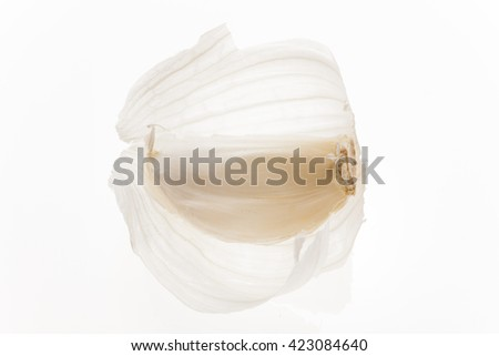 fresh garlic with flakes isolated on white