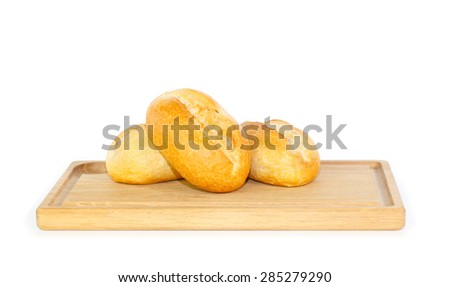 Fresh German bread rolls on a wooden breakfast tray against white background - stock photo