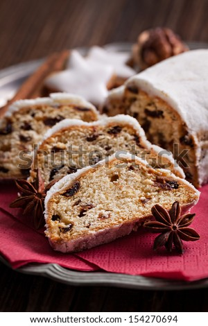 fresh german stollen cake and spices - stock photo