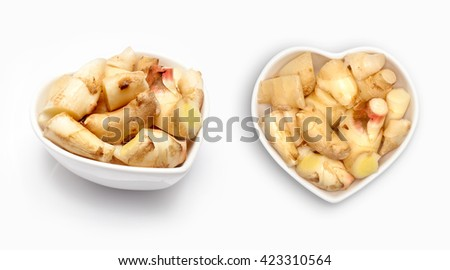 Fresh ginger  in a heart shaped bowl, isolated on white - stock photo