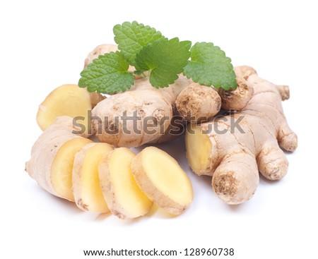 Fresh ginger on white ground - stock photo