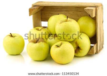 "fresh ""Golden Delicious"" apples in a wooden crate  on a white background - stock photo"