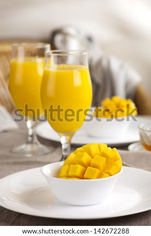 Fresh golden mango served with mango smoothie - stock photo