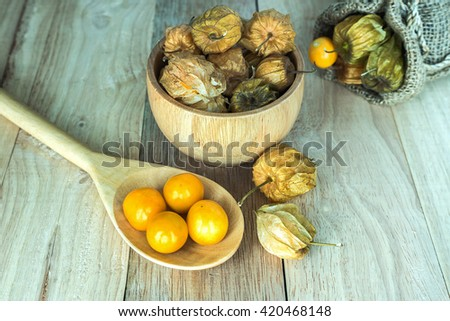Fresh Gooseberry Cape is delicious fruit in a wooden bowl - stock photo