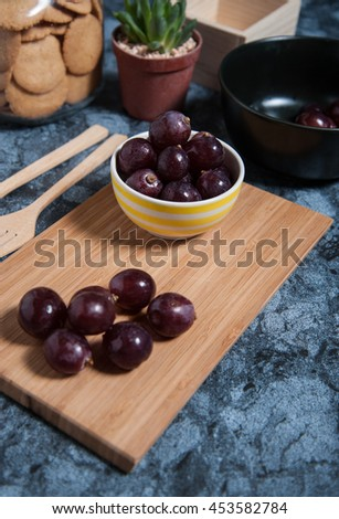 Fresh grape fruits on marble table. Flat lay. - stock photo