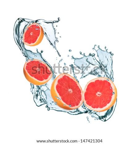 fresh grapefruits in water splash - stock photo